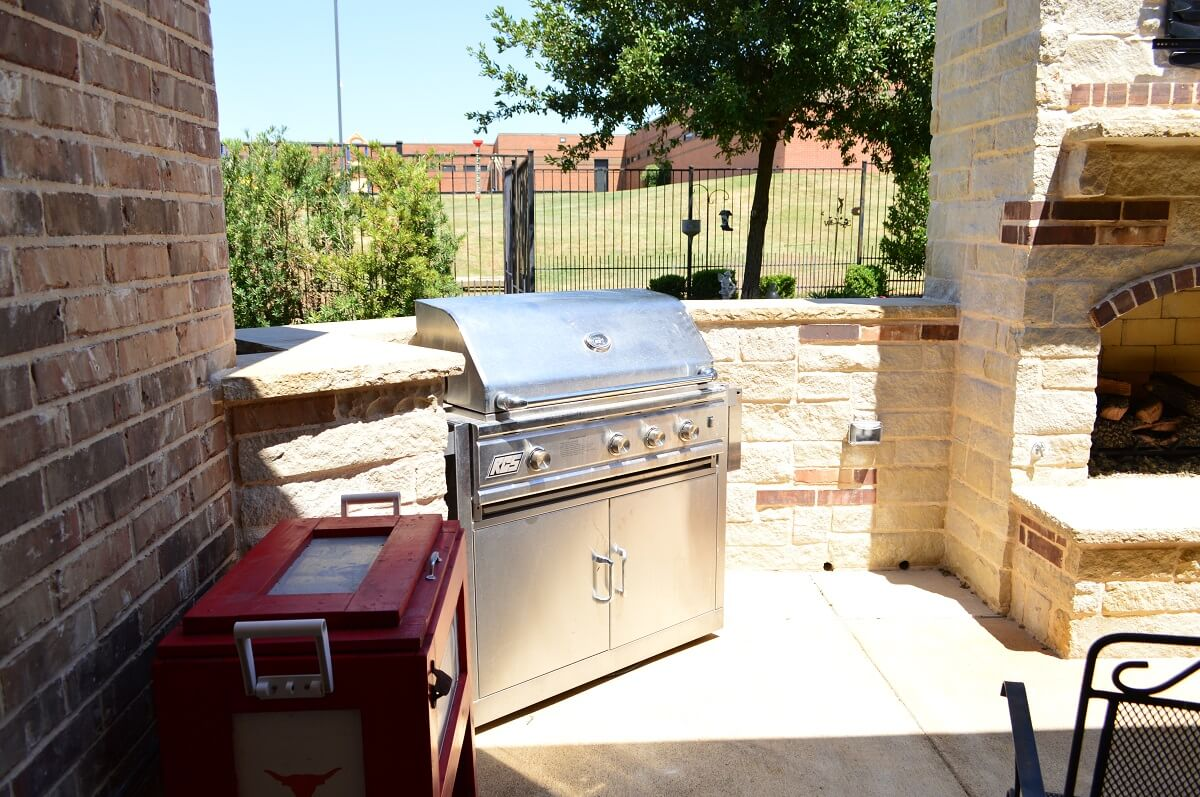 Outdoor kitchen with grill and hardscaping