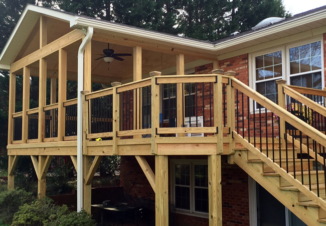 Pressure treated wood deck with open porch