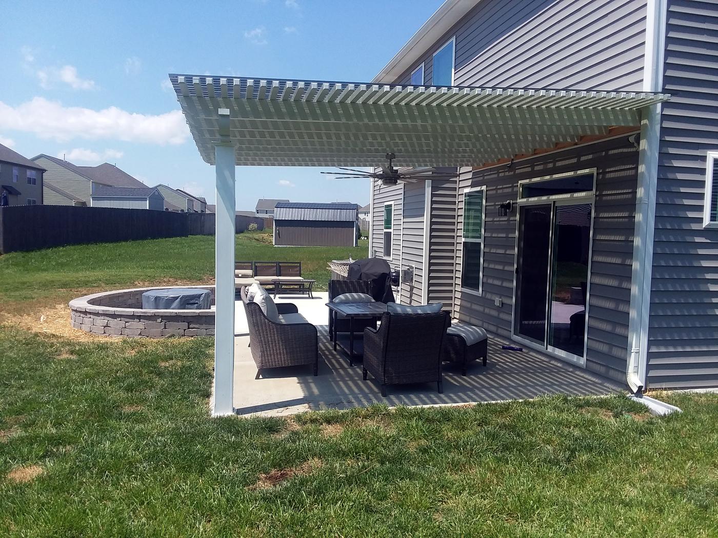 Pergola over patio seating area