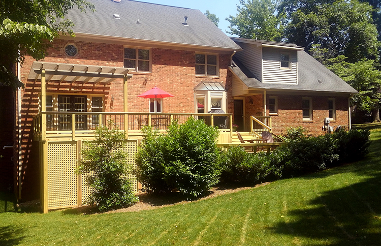 Deck off of brick house
