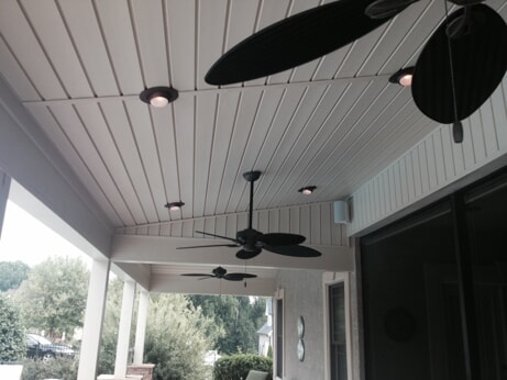 covered porch with ceiling fans and tongue and groove ceiling