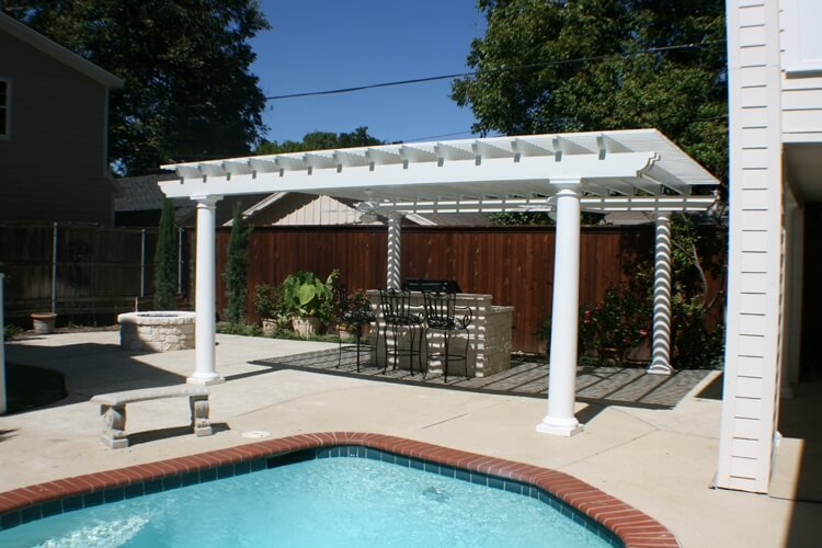 poolside patio with outdoor grill and fire pit