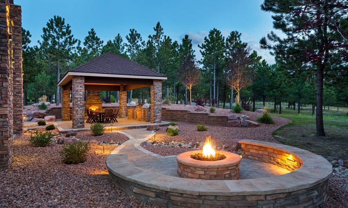 Shaded outdoor shaded seating area with two fire features