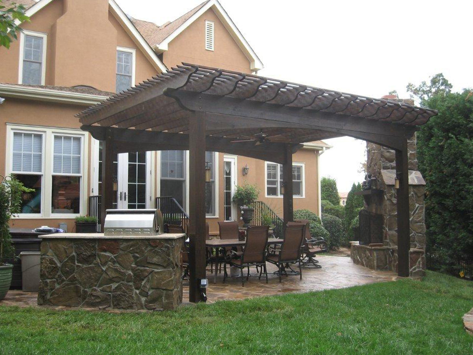 Large wooden pergola with outdoor kitchen