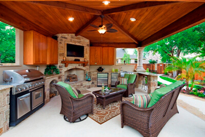 Furnished outdoor shaded pergola with kitchen and fire feature