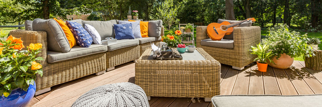 wood deck with couch and plants