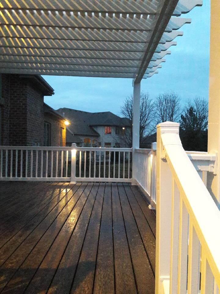 wood deck with pergola and railings