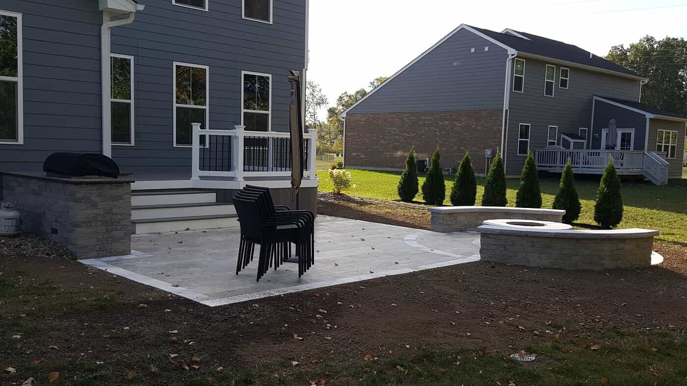 Newly installed deck with stairs and built in firepit