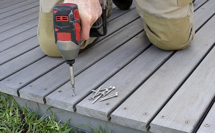 Person building a deck