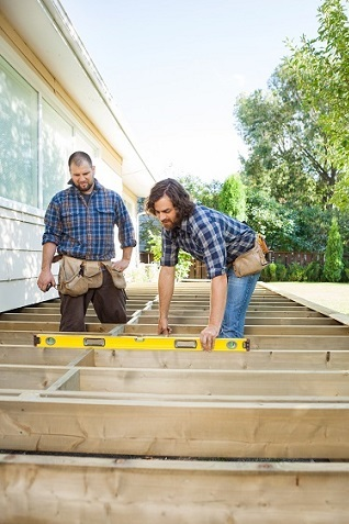 Construction workers building a deck