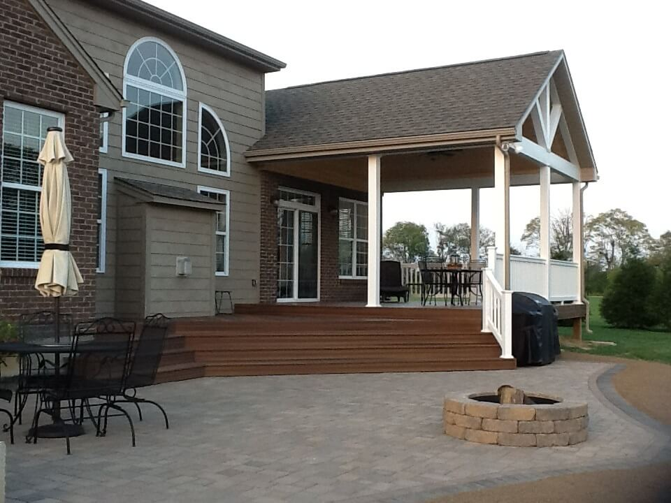 covered porch with fire pit