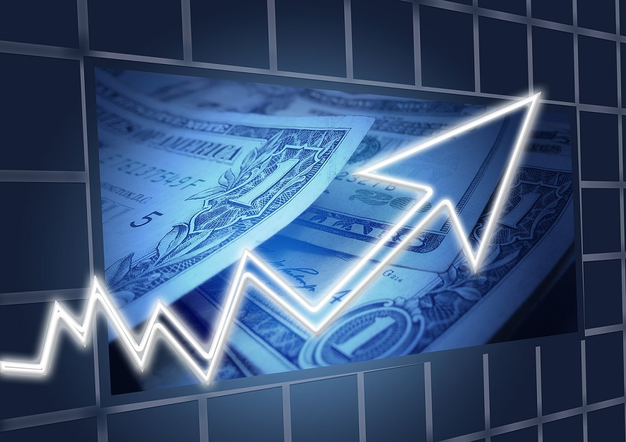 Dollar Bills and an arrow trending up