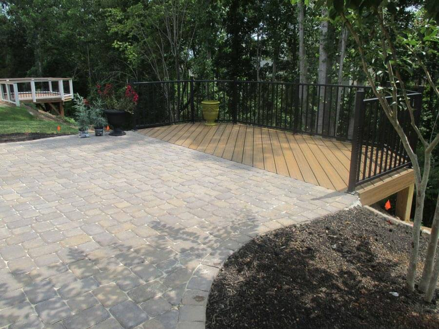 Walkway that leads to deck with railing
