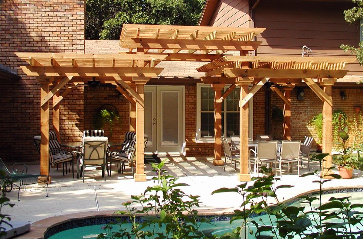 Pool with pergola and outdoor furniture