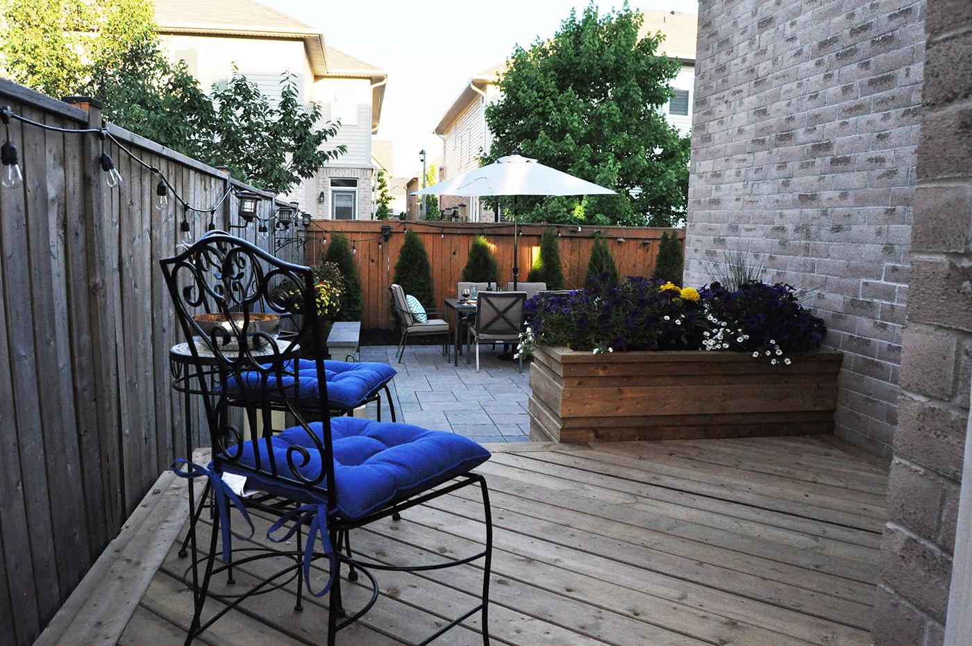 Wood deck and Unilock paver patio.