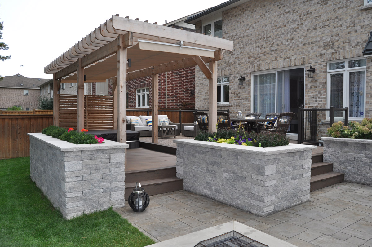 Back patio with pergola and dining set.