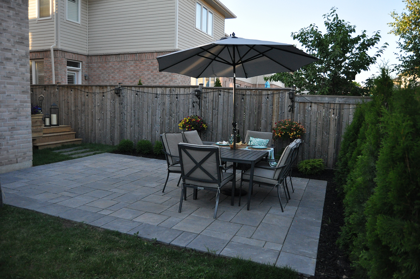 Unilock patio with table and chairs.