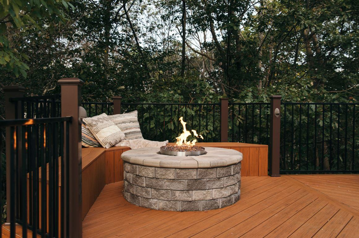Fire pit and bench seating on composite deck