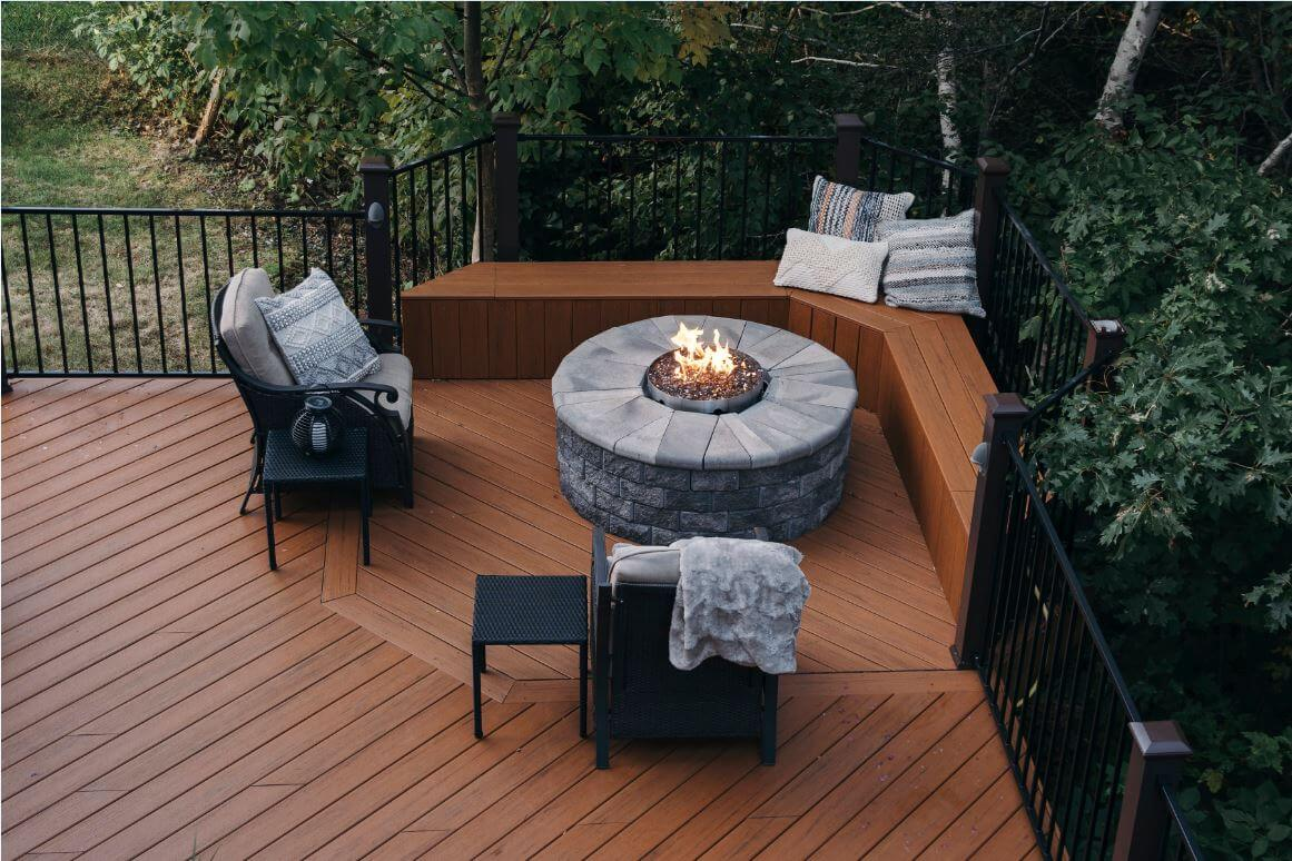 Elevated view of fire pit and seating area on composite deck