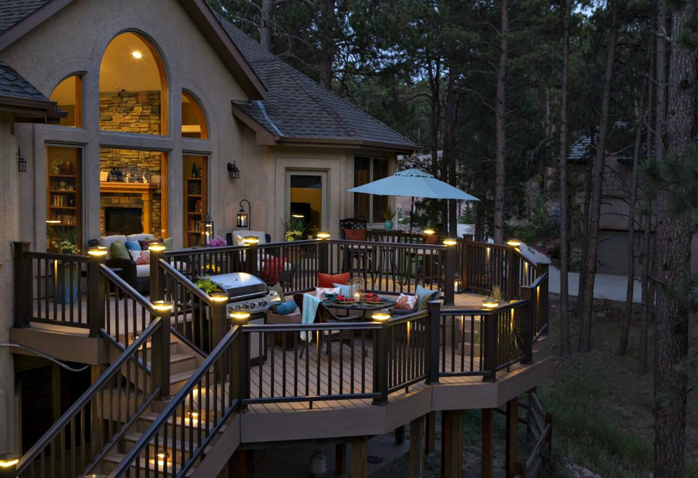 cozy outdoor living space with seating and grill on large deck